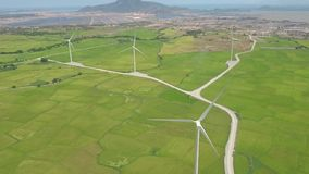 Windmill power station drone view. Aerial landscape wind turbine on green field for generation wind energy. Modern. Technology, clean renewable energy solution stock footage