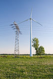 Windmill and powerlines Royalty Free Stock Photo