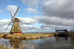 Windmill and pumping station Stock Photo
