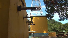 Windmill pumps water stock video footage