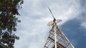 Windmill pumps water stock video