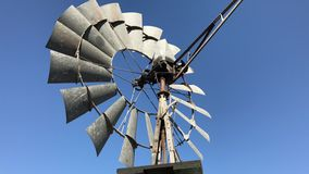 Windmill Quickly Turning in the Breeze on a Farm stock video