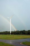 Windmill and rainbow. Stock Photos