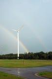 Windmill and rainbow. stock photos