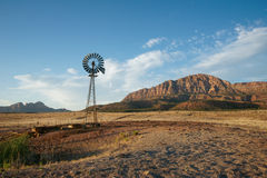 Windmill on Ranch Land. Rustic windmill on ranch land in the wilds of southwest United States stock photo
