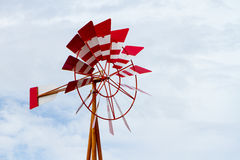 Windmill. Red windmill on blue sky royalty free stock photos