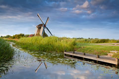 Windmill reflected in river Stock Photos