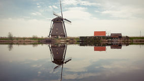 Windmill reflecting on water Stock Photography