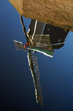 Windmill reflection. Dutch windmill reflected in water Royalty Free Stock Photography