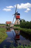 Windmill reflection. Dutch windmill reflected into water Stock Image