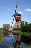 Windmill reflection. Dutch windmill reflected into water Royalty Free Stock Photos