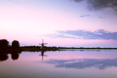 Windmill reflection in big lake Stock Photos