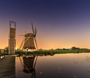 Windmill reflection at night Royalty Free Stock Photography