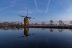Windmill with reflection in the water in Nieuwe Wetering. Sundown at windmill `the Googermolen` with reflection in the water on the Ringvaart canal in Nieuwe royalty free stock photos