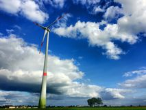 Windmill for renewable electric energy production Royalty Free Stock Photos