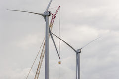Windmill Repair. Workers performing maintenance and repairs to windmill blade Stock Images