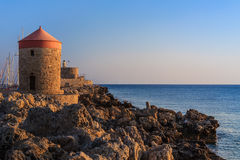 Windmill at Rhodes Greece. Mandraki Harbour windmill on the Island of Rhodes Greece royalty free stock images