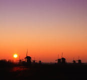 Windmill with rising sun royalty free stock images