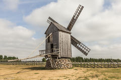 Windmill By The Road. Photo of a windmill by the road on the sunny day Stock Photos