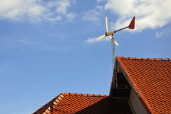 Windmill on the roof stock images