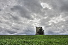 Windmill in ruins in front of a dramatic sky Stock Photography