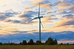 Windmill on rural field in the sunset. Wind turbines farm Royalty Free Stock Photos
