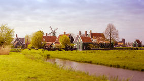 Windmill and rural houses in Zaanse Schans. Tilt-shift effect. Royalty Free Stock Image
