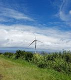 Windmill on a Rural Road by the Ocean Stock Images