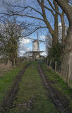 Windmill in rural road. Traditional Dutch landscape on a rural road Stock Photo