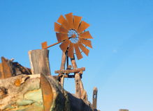 Windmill. Rusty windmill with blue sky in the background Royalty Free Stock Image
