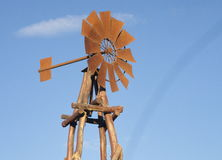 Windmill. Rusty windmill with blue sky in the background Royalty Free Stock Photography