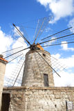 Windmill in the salt mines at Tripoli, Sicily, Italy Royalty Free Stock Images