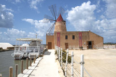 Windmill in the salt mines at Tripoli, Sicily, Italy Royalty Free Stock Photo