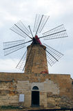 Windmill in salt pans of Trapani Stock Photo