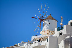 Windmill on Santorini. White Windmill on Santorini with blue sky Royalty Free Stock Photography