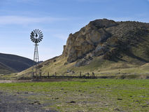 Windmill on a scenic ranch. Windmill and watering hole on a Nevada ranch Stock Photo
