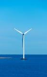 Windmill at sea Stock Photography