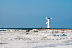 Windmill on the seashore Stock Photography