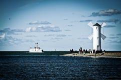 Windmill on the seashore Stock Photo