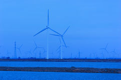 The windmill at the Seaside. In north china.It will provide new energy Royalty Free Stock Images