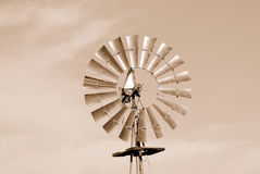 Windmill in Sepia. Windmill Pumping Water in Sepia Royalty Free Stock Photo