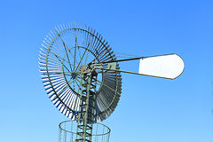 Windmill serving as water pomp Stock Images