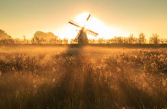 Windmill shining. Stock Photos