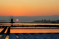 Windmill in a Sicilian saline. Located between the Mothia island and the city of Marsala Royalty Free Stock Photos