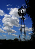 Windmill Silhouette. Blue sky with clouds Royalty Free Stock Photos