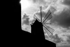 Windmill silhouette and clouds Stock Photos