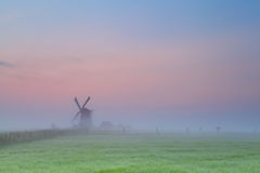 Windmill silhouette over sunrise sky Royalty Free Stock Photos