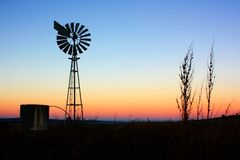 Windmill silhouette at sunrise. Stock Photography