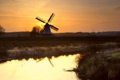 Windmill silhouette at sunrise Royalty Free Stock Image