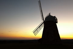 Windmill Silhouette at Sunset Stock Images